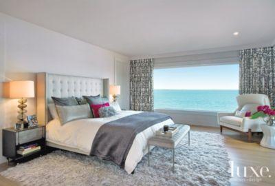 modern bedroom with ocean view Neutral Modern Master Bedroom with Ocean View - Luxe Interiors + Design