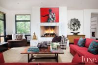 Neutral Eclectic Living Room with Red Couch and Artwork ...