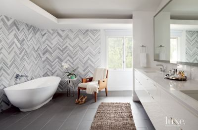 modern armchair design office executive chair white bathroom with herringbone wall tiles - luxe interiors +