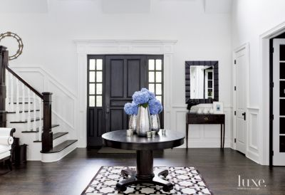 Contemporary White Foyer with Antique Center Table  Luxe