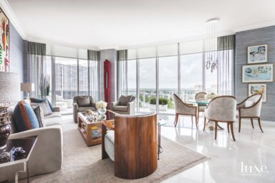 contemporary artwork living room beachy gray with miami view and red luxe