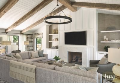 how to decorate living room with tv over fireplace large art reclaimed wood vaulted ceiling and neutral couch
