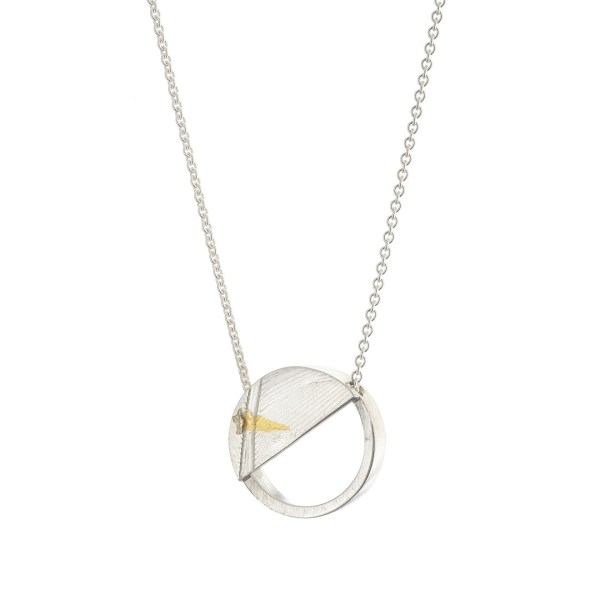 Silver circle pendant with a diagonal semi circle section with a feather pattern and a dash of 24 carat gold