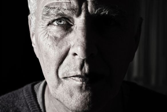 Older man looking directly into camera
