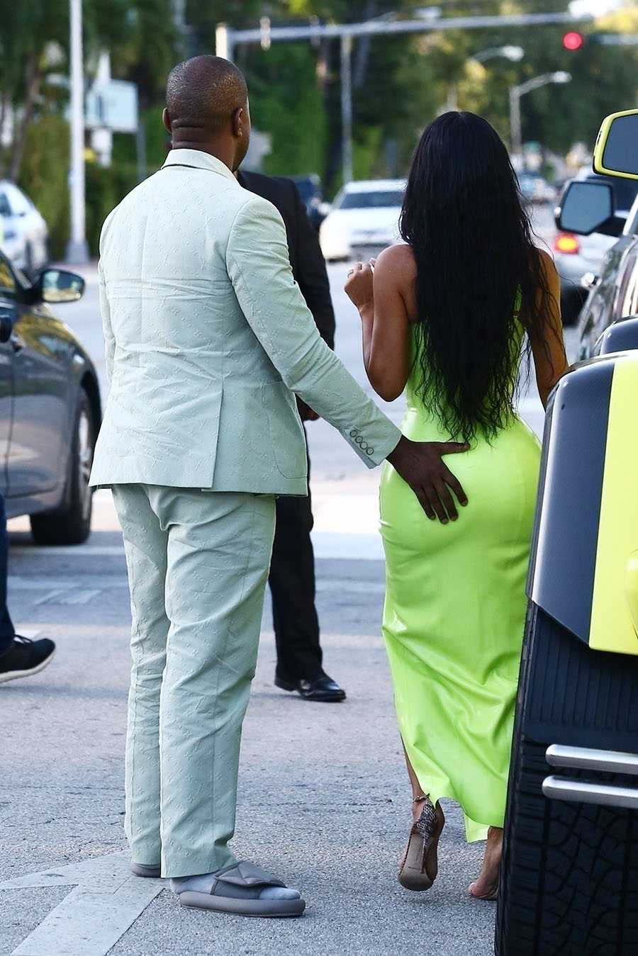 Kim Kardashian gets a helping hand from her man Kanye West