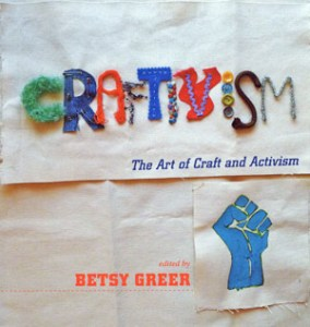 Betsy Greer, ed. Craftivism: The Art of Craft and Activism (2014, Arsenal Pulp Press, Vancouver). Front cover, a textile trompe l'oeil, with the image actually printed on a flat sheet of heavy paper.