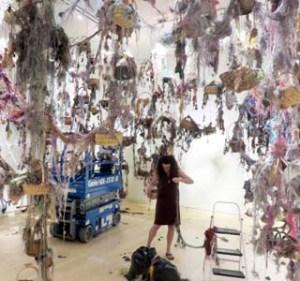 Susan Lenz installing Threads: Gathering My Thoughts (2016) at the Mesa Arts Center near Phoenix, Arizona.