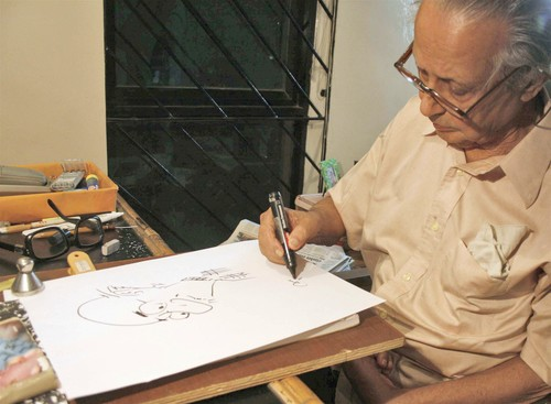 R K Laxman at his desk in Pune. Photo by Vilas Avachat for the Times.