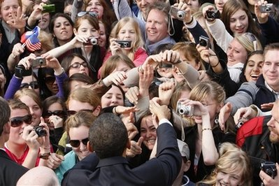 Obama greets supporters. AP photo by Charles Dharapak