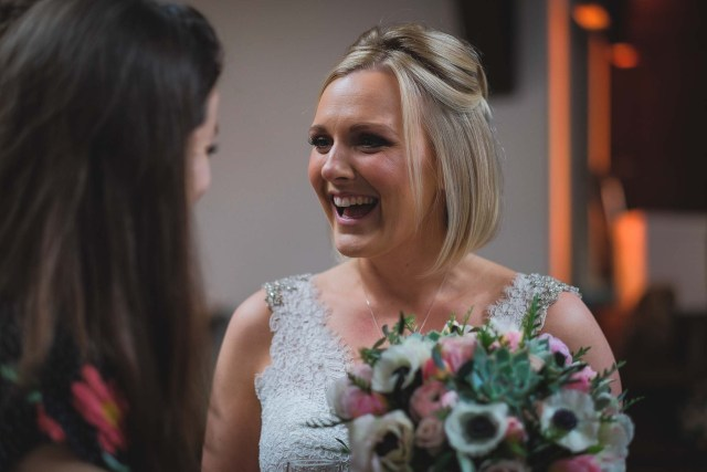 Bride talking to guests at Cheshire wedding