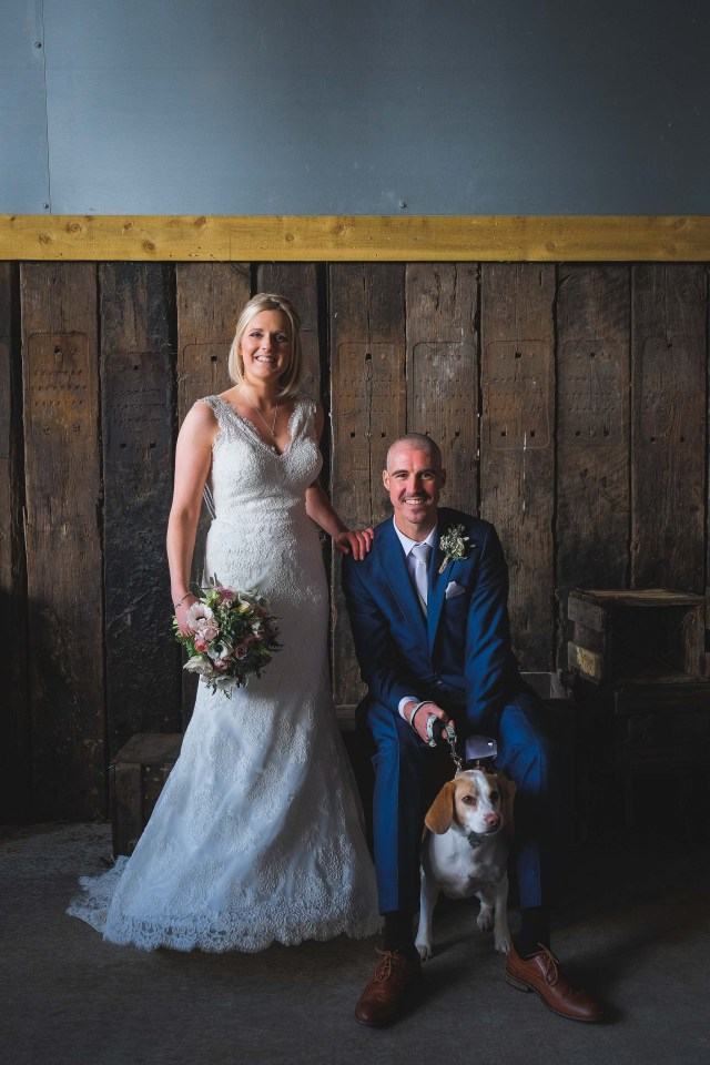 Bride and Groom with their dog at Cheshire wedding