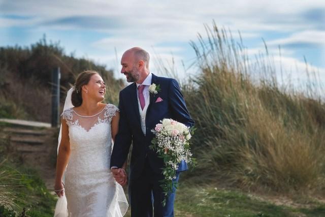 Enjoying a seaside stroll - documentary wedding photography in Merseyside