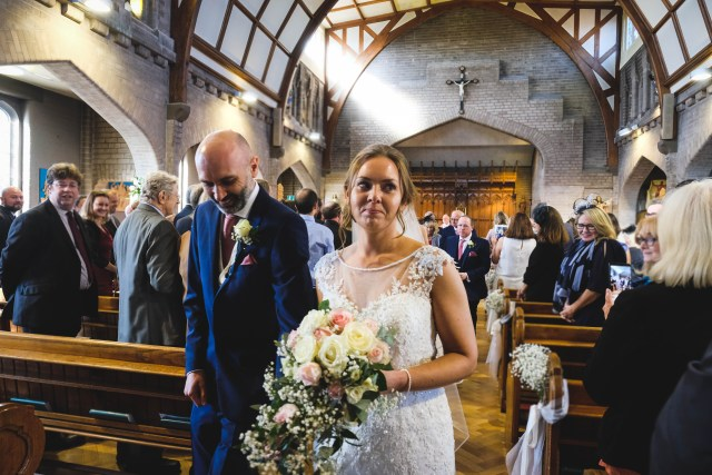 Bride and groom walk down the aisle at Saint Catherine's Church in Hoylake