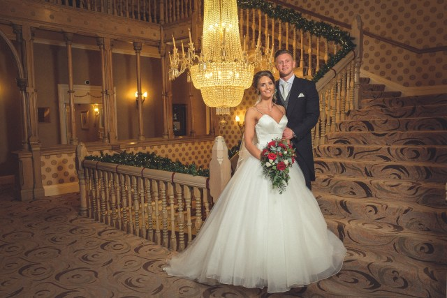 Photo of bride and groom inside Chester Grosvenor Hotel by staircase