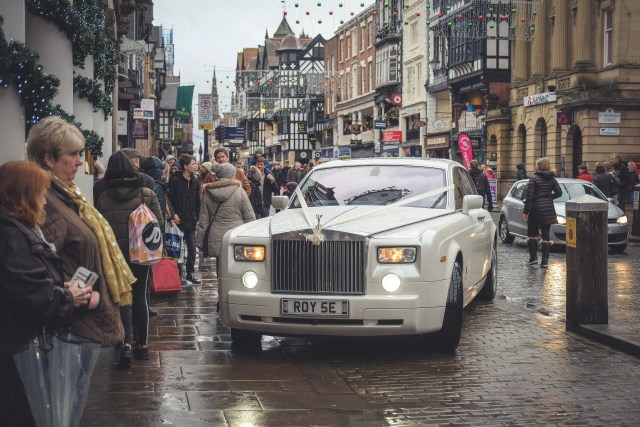 White Rolls Royce wedding car arriving at Chester Grosvenor Hotel