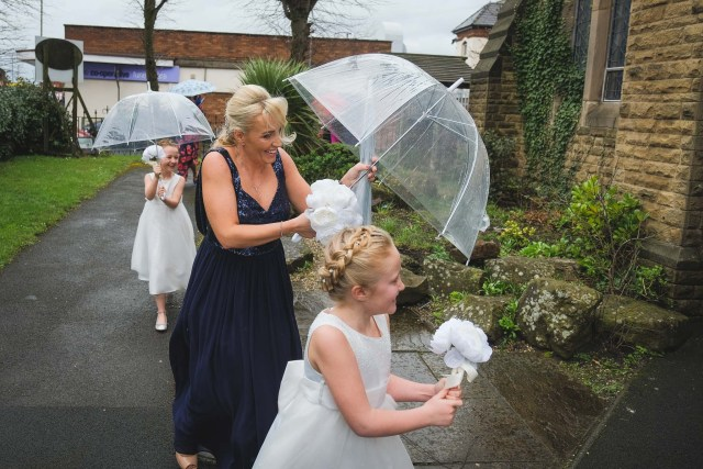 Bridesmaids and flower girls at rainy wedding in Liverpool