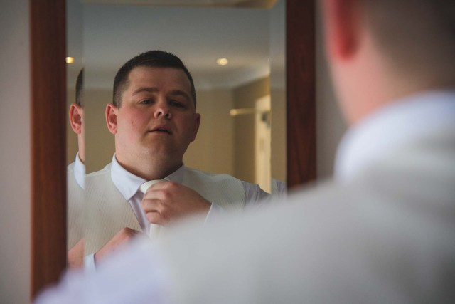 Groom getting ready at the Park Hotel in Netherton, Liverpool