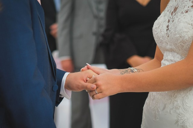 Holding hands while exchanging marriage vows