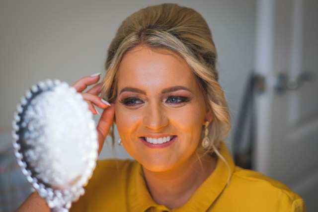 Liverpool bride checking her makeup