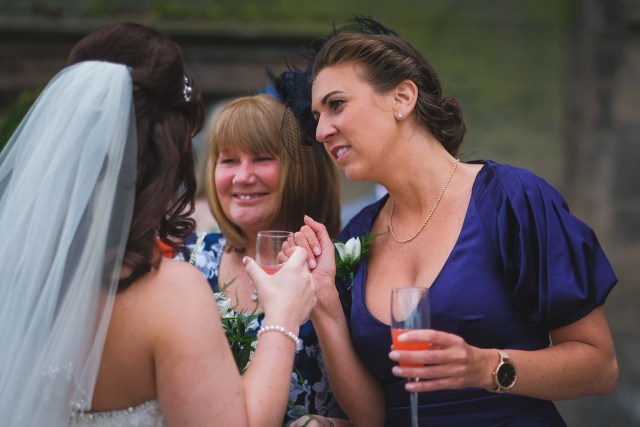 Guests congratulate bride on her dress
