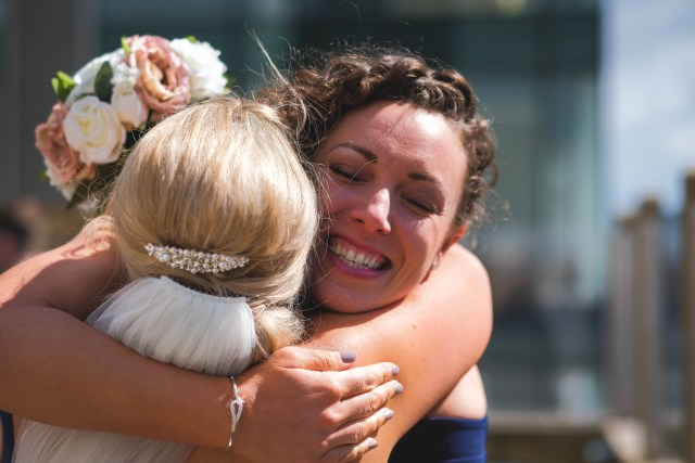 Wedding guest hugging bride in Liverpool