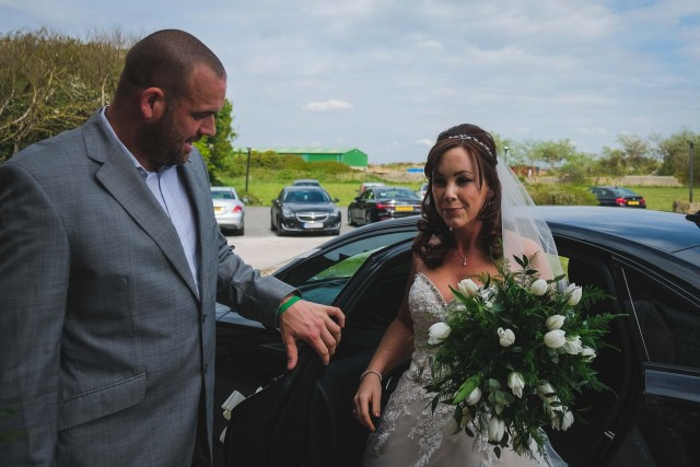 Bride getting out of car at Wirral Wedding