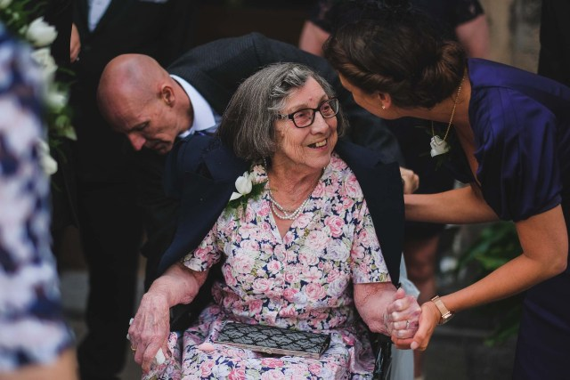 Elderly wedding guest smiling at Leasowe Castle