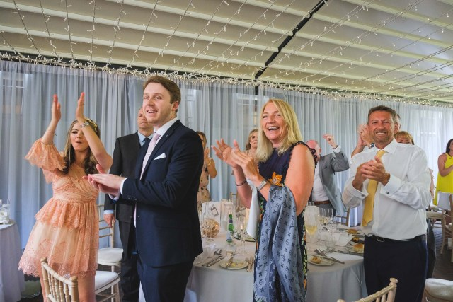 Guests at Cheshire wedding applauding