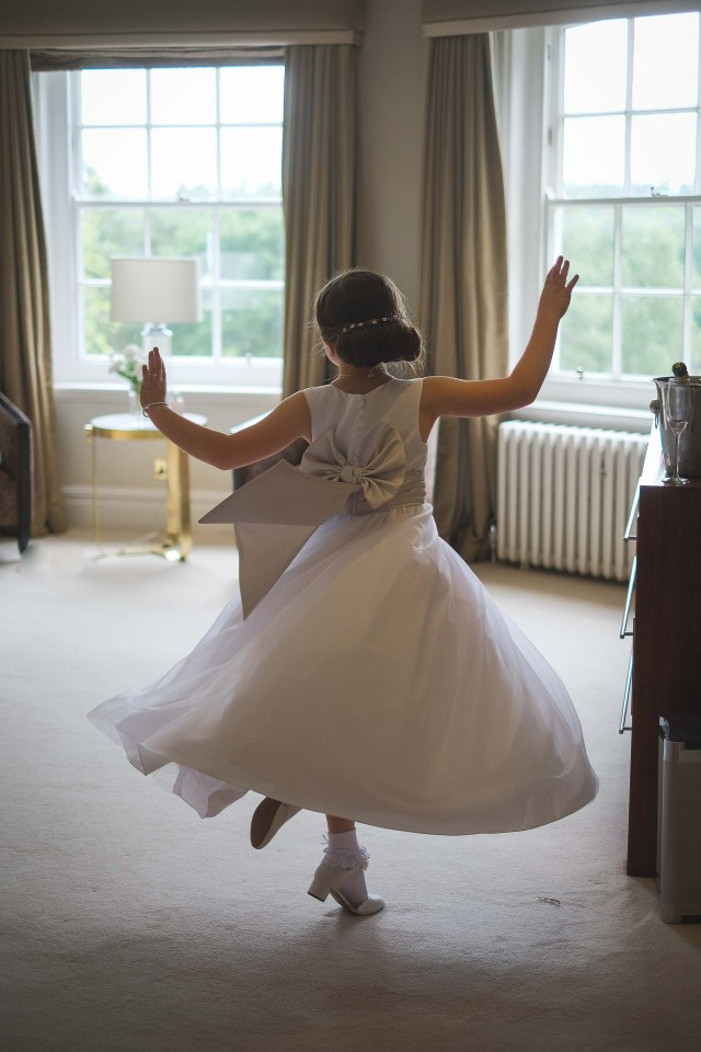 Excited flower girl, documentary wedding photographers