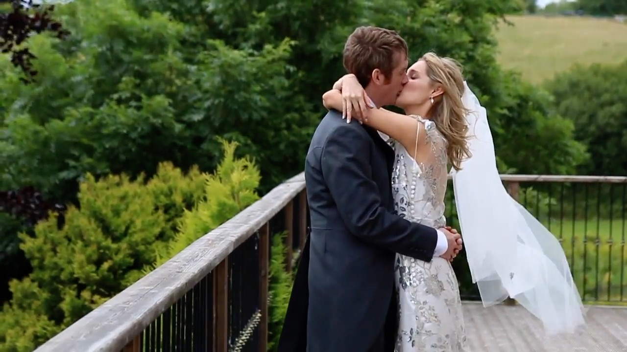 Katy & Dan kissing on the Terrace at Lancashire wedding