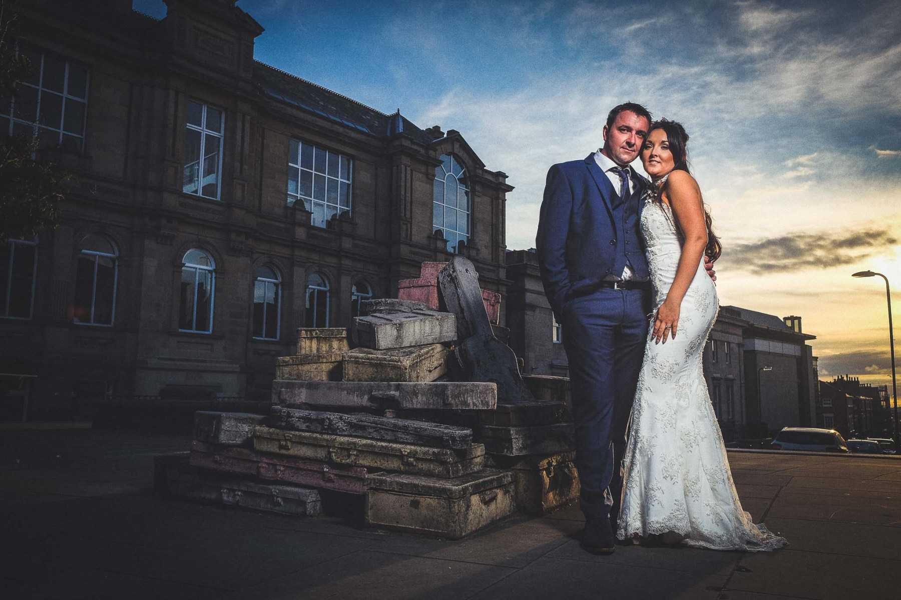Bride and Groom in front of Liverpool Hope Street Suitcases