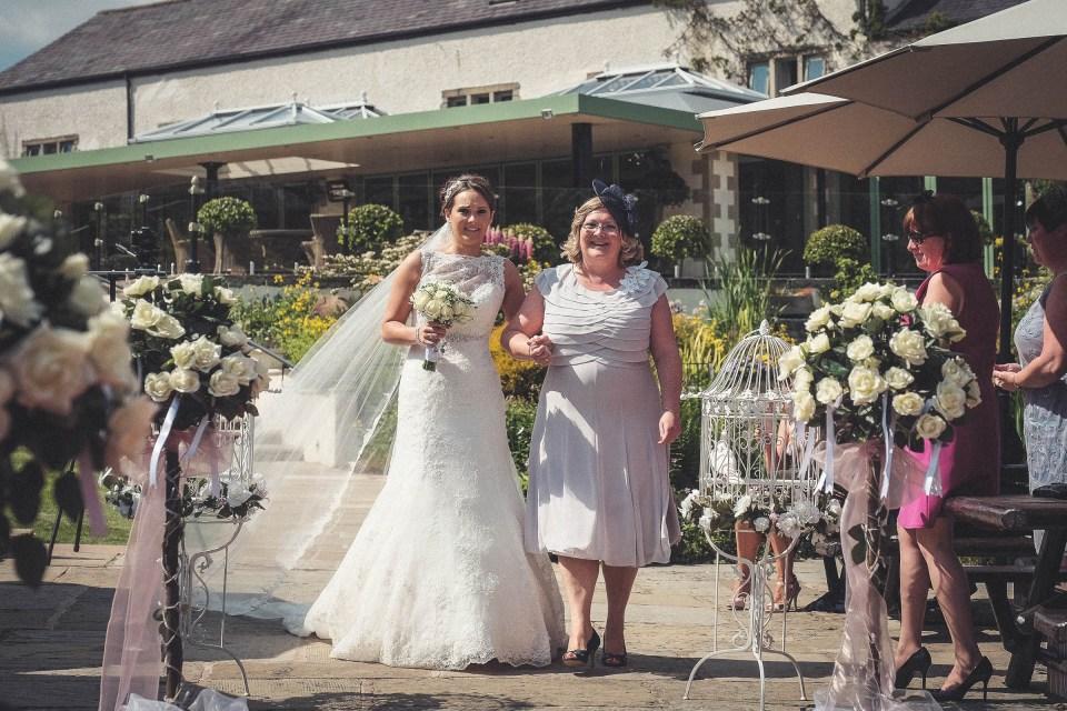 Gibbon Bridge garden wedding bride walking down aisle