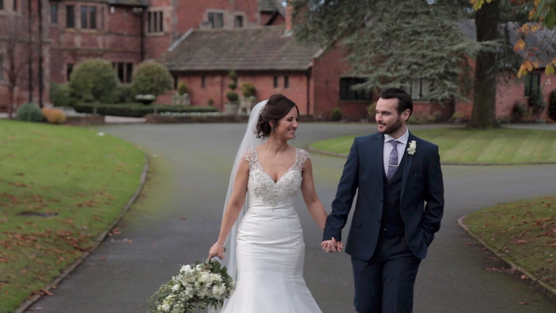 Bride and Groom having a romantic walk at Colshaw Hall in Cheshire