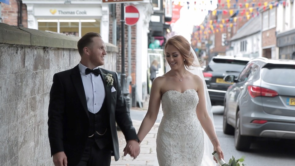 Bride and groom walking down King Street in Knutsford, Cheshire