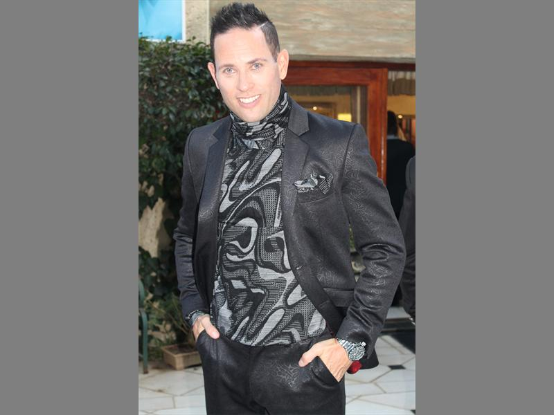 Confidence is key... Singer songwriter Garth Taylor suits up in an Ephraim Molingoana Design.