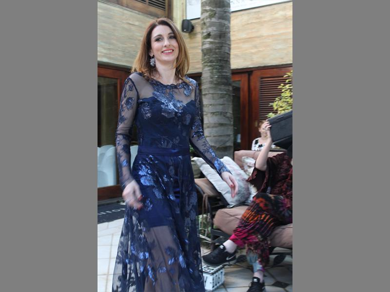 Blue gem... Singer Louise carver wears a Vesselina Pentcheva design and walks around the patio for all to see.