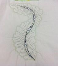 Paula's green feather