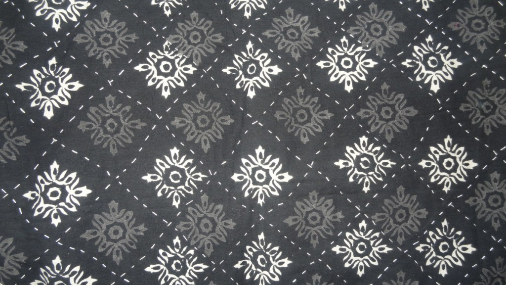 Black and white block printed quilted bedspread