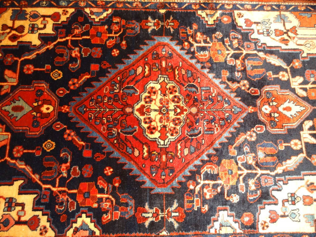 Semi-antique Nahavand carpet from Persia.