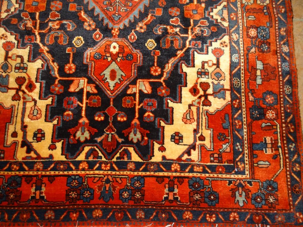 Semi-antique Nahavand carpet from Persia.