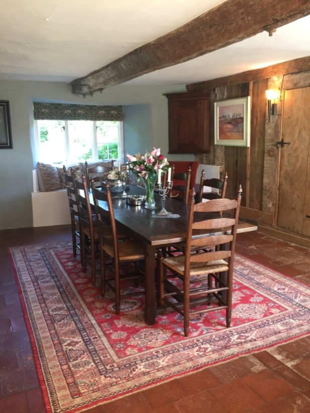 Afghan carpet in the dining room of a house in Devon