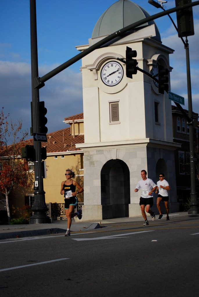 Participants in last year's San Elijo Hills 5K pass the clock tower near the town square.  The 2012 San Elijo Hills 5K is set for Saturday, Jan 21, beginning at 8 a.m.