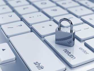 Illustration of chrome padlock on the computer keyboard, Secure Your Business Wireless Network.