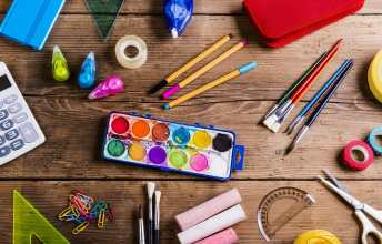 Art supplies on wood desk, Create an art studio for people with ADHD.