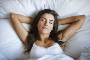 Woman sleeping, Sleep better with ADHD.