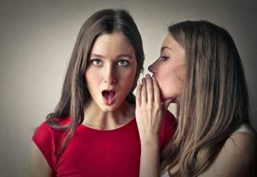 blog post secrets, improve blog posts, woman telling secret.