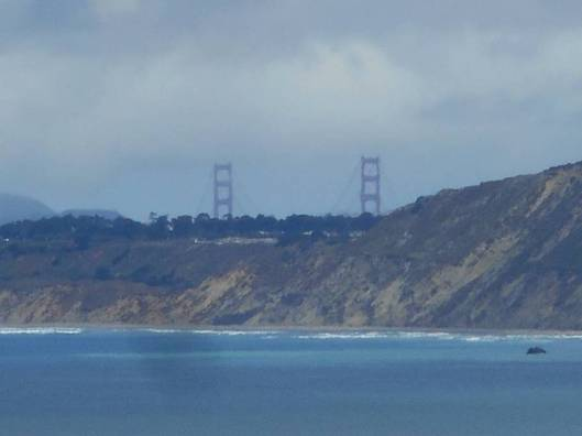Picture taken from our windows: Blue Pacific Ocean and the Golden Gate Bridge.