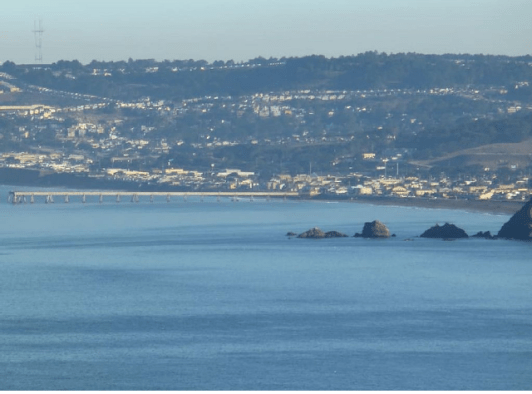 Picture taken from our windows: Sharp Park long fish pier and SF's Sutro Tower