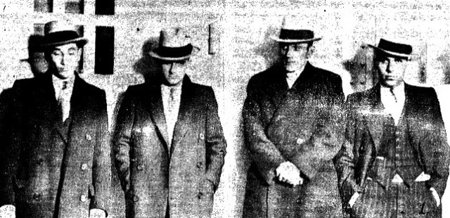 Accused bank robbers, from left, Arthur Brown, Ted Patterson, Jack McCoy and Frank Martini paraded for reporters after their arrest (courtesy State Journal-Register)