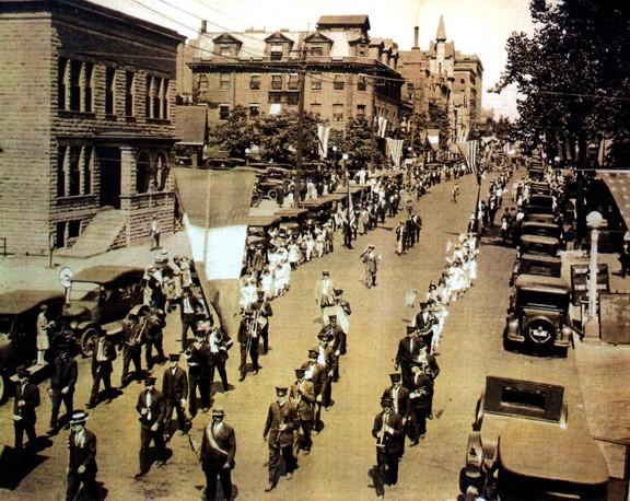 Columbus Day parade, Oct. 12, 1926, along Capitol Avenue. Leading the parade (in sash) is Leo Montalbano (photo courtesy Sam Montalbano)
